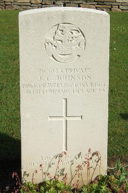 The headstone for John George Johnson in Le Fermont Cemetery.