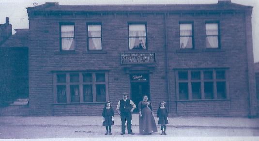 The original Waggon and Horses, with George and Elizabeth and their two daughters, probably Nelley and Ellen. The photograph is probably of about 1900.
