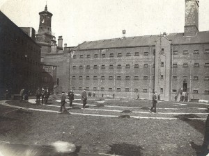 Wakefield prison c1916 pos. with CO's exercising. Unknown source