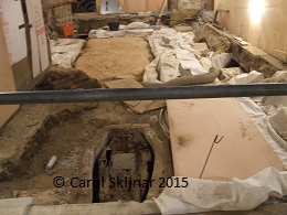 Excavated floor showing one of the coffins